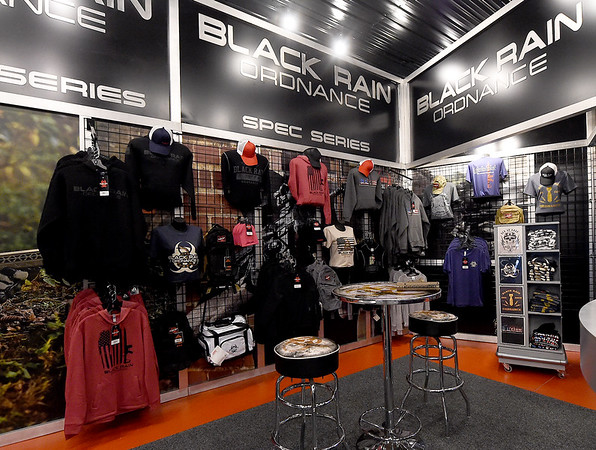 Black Rain apparel lines the walls at Black Rain Ordnance on Thursday. The company has grown from a small business to a company that sells about 10,000 guns a year and will celebrate its 10th anniversary on Tuesday.<br /> Globe | Laurie Sisk
