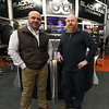 From the left: Black Rain Ordnance Vice President Charlie Spires and President Justin Harvel stand inside their store on Thursday. The company has grown from a small business to a company that sells about 10,000 guns a year and will celebrate its 10th anniversary on Tuesday.<br /> Globe   Laurie Sisk