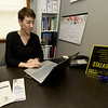 Ali Smith, Prevention Education Specialist at Safehouse Crisis Center, works in her office on Wednesday in Pittsburg. January is Human Trafficking and Stalking Awareness Month.<br /> Globe | Laurie Sisk
