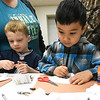 "From the left: Peyton Lych, 4 and Jordan Khang, 4, create hibernating bears using crayons and cotton balls during the Wildcat Glades Friends Group's program for preschoolers entitled ""Hibernation: More Than Just a Long Nap"" on Saturday at the Empire Market. About 20 people attended the event.<br /> Globe 