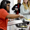 Pittsburg State University international student Kamya Sahay helps serve a welcoming dinner to 80 new international students on Wednesday night at the St. John Lutheran Church Activity Center in Pittsburg. About 120 people attended the event, which began four days of orientation for the students.<br /> Globe | Laurie Sisk
