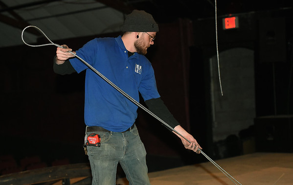 Cody Washburn, of A to Z Theatrical, prepares galvanized aircraft cable for installation of a new fly system at Joplin Little Theatre on Friday. The work is part of a modernization of the theatre and allows more options for the technical side of productions at the theater.<br /> Globe | Laurie Sisk