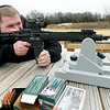 Jason Lankford, customer service and technical manager at Black Rain Ordinance, fires a 300 Blackout on the test range at Black Rain Ordnance on Thursday. The company has grown from a small business to a company that sells about 10,000 guns a year and will celebrate its 10th anniversary on Tuesday.<br /> Globe | Laurie Sisk