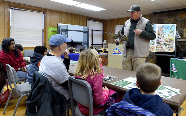 Kevin Badgley, of the Missouri Department of Conservation, uses a model of a Northern Flicker to help kids learn how to identify specific birds during the Kids Christmas Bird Count on Saturday morning at the Walter Woods Conservation Area.<br /> Globe   Laurie Sisk