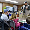 Kevin Badgley, of the Missouri Department of Conservation, uses a model of a Northern Flicker to help kids learn how to identify specific birds during the Kids Christmas Bird Count on Saturday morning at the Walter Woods Conservation Area.<br /> Globe | Laurie Sisk