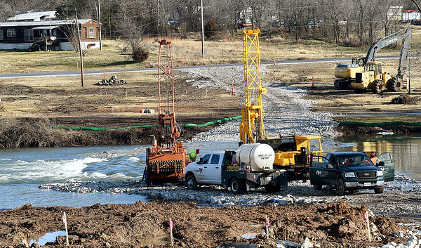 Crews continue work Friday on construction of a new low water bridge underneath I-44 on Shoal Creek.<br /> Globe | Laurie Sisk