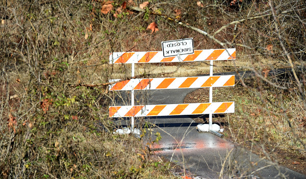 Portions of a trail at Wildcat Glades remain closed on Friday during construction of a new low water bridge in McEndoe Park.<br /> Globe | Laurie Sisk