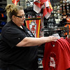 Julie McKinley, manager at Pro Image Sports in Northpark Mall arranges Kansas City Chiefs quarterback Patrick Mahommes shirts on a display on Wednesday at the store. Fans are gearing up for the Chiefs palyoff game against Indianapolis on Saturday.<br /> Globe | Laurie Sisk