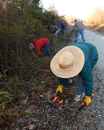 Front to back: Bev Sturgis, Pat Wakefield, Paul Teverow, James Manning and Bob Herbst work to clear brush on a half-mile section of the Ruby Jack Trail in Oronogo on Saturday morning.<br /> Globe | Laurie Sisk
