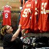 Julie McKinley, manager at Pro Image Sports in Northpark Mall arranges Kansas City Chiefs jerseys on Wednesday at the store. Fans are gearing up for the Chiefs palyoff game against Indianapolis on Saturday.<br /> Globe | Laurie Sisk