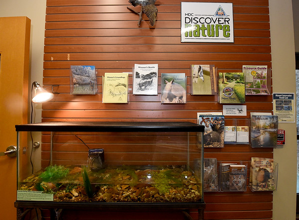 Educational materials line a wall at the Shoal Creek Conservation Education Center on Friday. Although renovations are taking place at the center, educational programs and information are still available at the center. <br /> Globe | Laurie Sisk
