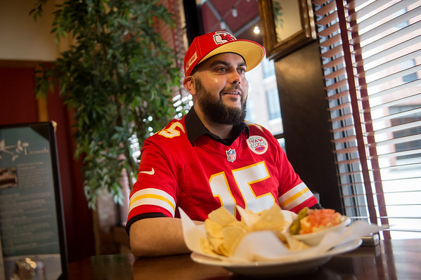 Jake Dhar talks about his love for the Kansas City Chiefs during an interview at the Red Onion Cafe on Tuesday.<br /> Globe | Roger Nomer
