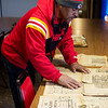 Cornell Harbin talks about his scrapbook collection of Kansas Chiefs articles on Wednesday.<br /> Globe | Roger Nomer