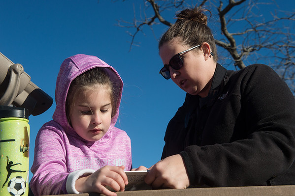 Riley, 5, and Lauren Copple look at a field guide for birds during Saturday's Kids Christmas Bird Count at the Shoal Creek Conservation Education Center.<br /> Globe | Roger Nomer
