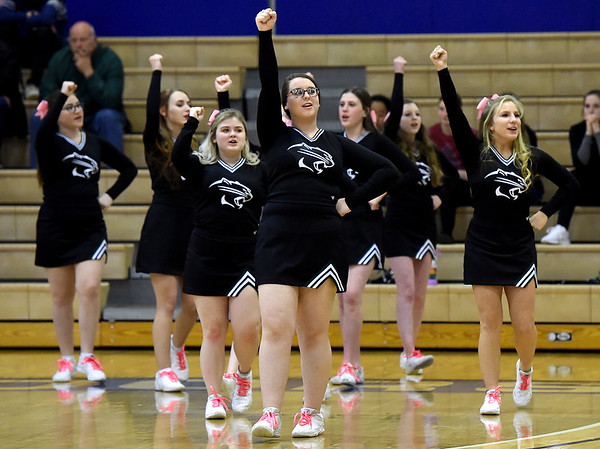 College Heights cheerleaders keep Cougars fans excited during their basketball game against Jasper on Friday night at Ozark Christian College.<br /> Globe | Laurie Sisk