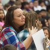 Paige Talbot, fifth grade, gets a hug from her mother Chelsea after learning about her Make-A-Wish trip to Hawaii on Friday at the Carthage Intermediate Center.<br /> Globe | Roger Nomer