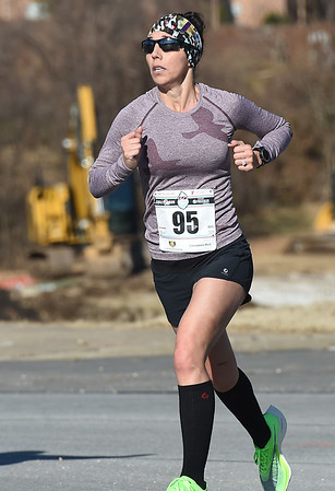 Christy Beebe nears the finish line as the top female runner and third finisher overall during the Chilly 5K on New Years Day at the Joplin Family YMCA. <br /> Globe | Laurie Sisk