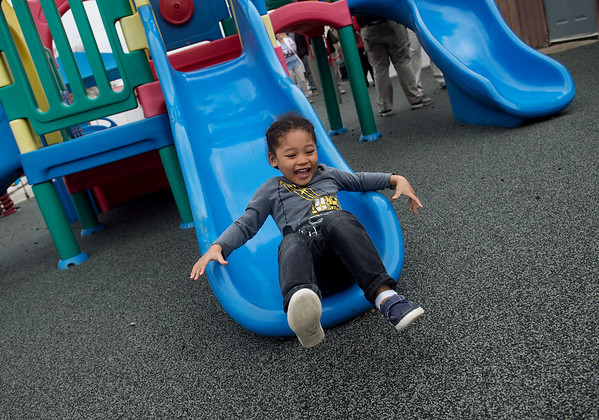 Makio Warren-Kuriha, 4, makes a soft landing on the new rubberized surface of the Midtown Joplin Head Start playground on Thursday.<br /> Globe | Roger Nomer