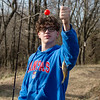 Corbin Foglesong, Carl Junction sophomore, shows off his catch at the Carl Junction outdoor classroom on Tuesday.<br /> Globe | Roger Nomer