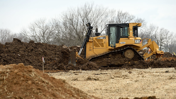 A dozerhelps level an area near the intersection of Hwy 43 and Hwy 126 on Thursday for a staging area for the construction of wind turbines near Liberal.<br /> Globe | Laurie Sisk