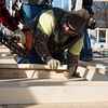 Ed Russell, production team leader with General Mills, helps assemble a wall on Monday as part of a Habitat for Humanity build in Joplin.<br /> Globe | Roger Nomer