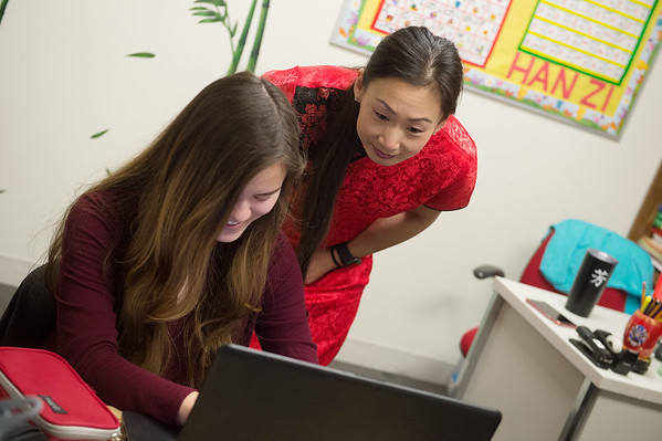 Fang Martin works with Jade Eschenbrenner, senior at Thomas Jefferson Independent Day School, on an essay during class on Tuesday at the school.<br /> Globe | Roger Nomer