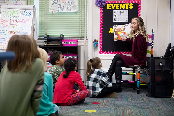 Holly Hasty reads to her second-grade students on Jan. 30 at West Central Elementary.<br /> Globe | Roger Nomer