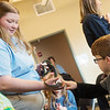 Keagan Arnold, 8, Joplin, touches a Speckled King Snake held by Jessie Ballard, naturalist, during a presentation on Missouri snakes at the Shoal Creek Conservation Education Center on Friday.<br /> Globe | Roger Nomer