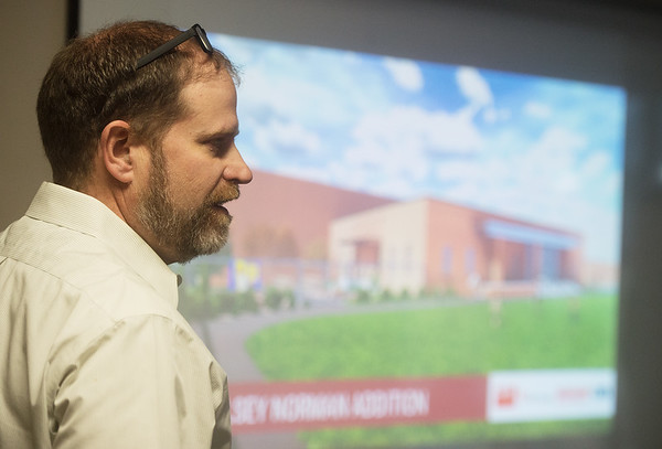 Chad Greer, principal architect for Corner Greer and Associates, talks about a rendering for the proposed elementary school at Dover Hill on Tuesday at the Joplin Area Chamber of Commerce.<br /> Globe | Roger Nomer