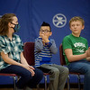 (from left) Paige Talbot, fifth grade, Quill Baxter, third grade, and Austin Davis, sixth grade, learn about their Make-A-Wish trips during an assembly at the Carthage Intermediate Center.<br /> Globe | Roger Nomer