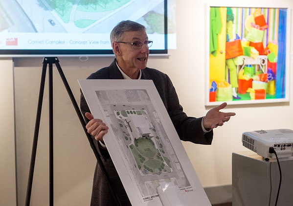 Clifford Wert, president and CFO of Connect2Culture, talks about a scale model of the Harry M. Cornell Arts & Entertainment Complex during a press conference at the Spiva Center for the Arts on Monday.<br /> Globe | Roger Nomer