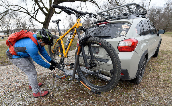 Mountain bike enthusiast Jeff Chance unloads his bike in preparation for a ride in a wooded area of Morse Park on Saturday.<br /> Globe | Laurie SIsk
