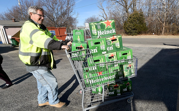 Joplin Recycling Center attendant Scott Patterson transport bottles for recycling on Tuesday at the center. <br /> Globe | Laurie Sisk