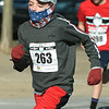 Elam Seedorf shields his face from a cold, brisk wind at the start of the Chilly 5K at Memorial Hall during the annual New Year's Day event.<br /> Globe | Laurie Sisk