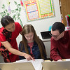 Fang Martin works with Beth Patterson and Preston Johnson, seniors at Thomas Jefferson Independent Day School, on a Chinese-language essay on Tuesday at the school.<br /> Globe | Roger Nomer