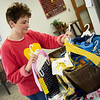 St. Mary's Elementary Principal Joanne Lown looks over donations to Operation Jammies collected by students over Catholic Schools Week on Friday.<br /> Globe | Roger Nomer