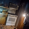 Megan Stanley looks over her destroyed kitchen on Thursday.<br /> Globe | Roger Nomer
