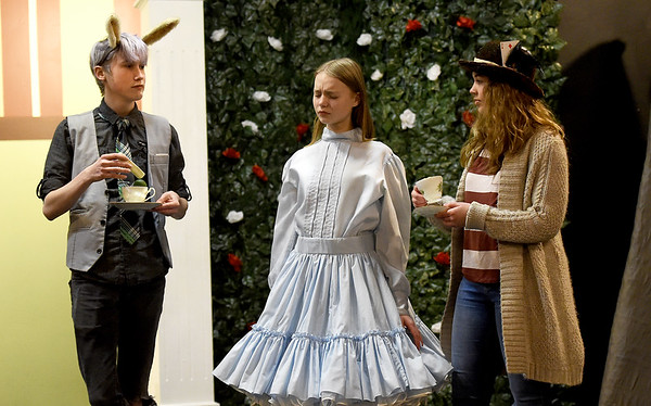 """From the left: Jeremiah Blotter (the """"Hare,) Grace Dalrymple (Alice) and Joy Proctor (Madhatter) rehearse their roles for the Stained Glass Theatre production of """"Alice in Wonderland"""" on Thursday night at the theatre.<br /> Globe 