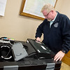 Charlie Davis, Jasper County clerk, checks a voting machine at the Jasper County Courthouse in Carthage on Monday.<br /> Globe | Roger Nomer