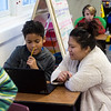 Chee Harris, a student teachers from Missouri Southern, works with Dante Adams, fourth grade, on Jan. 30 at Columbia Elementary.<br /> Globe | Roger Nomer