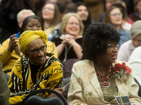 """Patsy Robinson (left) and Irene Carr sing along with """"When the Saints Go Marching In"""" during Monday's Dr. Martin Luther King Jr. Day Celebration at Missouri Southern.<br /> Globe 