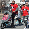 Jason and Cindy Evans make their way through the course during the Chilly 5K on New Year's Day at Memorial Hall.<br /> Globe | Laurie Sisk