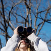 Bailee Evans, 12, Joplin, looks for birds during Saturday's Kids Christmas Bird Count at the Shoal Creek Conservation Education Center.<br /> Globe | Roger Nomer
