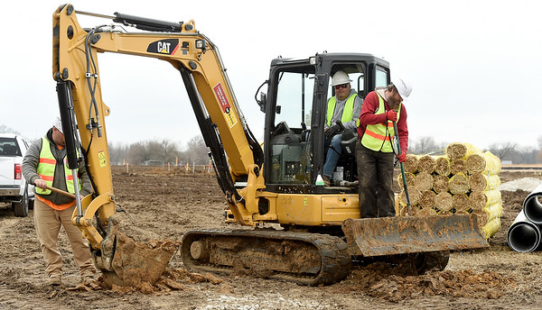 Workers on Thursday begin preparing a large area near the intersection of Hwy 43 and Hwy 126 for the site of a staging area for the construction of wind turbines near Liberal.<br /> Globe | Laurie Sisk