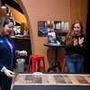 Lacie Waggoner, marketing manager with Arvest Bank, plays a game from Main Street Axe Company as Michelle Fowler, owner of Main Street Axe Company, cheers for her on Tuesday at the Joplin Area Chamber of Commerce Business Expo at Downstream Casino.<br /> Globe | Roger Nomer