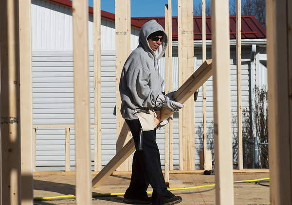 Elvia Alanis, a worker with General Mills, helps with wall construction on Monday as she volunteers with a Habitat for Humanity build in Joplin.<br /> Globe | Roger Nomer