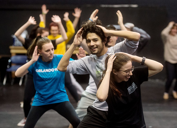 """Logan Carnes, a junior at Carl Junction High School, and Alexandria Gibson, a Missouri Southern sophomore from Gravette, Ark., practice choreography for """"Mama Mia"""" at the Bud Walton Black Box Theatre on Friday.<br /> Globe   Roger Nomer"""
