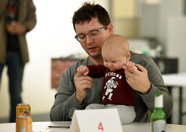 Trivia tot Maxwell DeGraff, 7-months, joins his father, Jordan DeGraff, at Trivia Night on Thursday night at the Spiva Center for the Arts. The trivia night is the first Thursday of each month, with cash prizes and free adult beverages. A portion of the proceeds go to benefit Spiva.<br /> Globe | Laurie Sisk