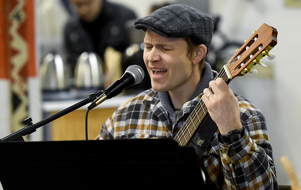 """Andrew Pommert entertains guests at the Empire Market with his rendition of """"Fly Me to the Moon"""" on Saturday. Although wintry weather kept some patrons away, Pommert was on hand to warm their hearts with his easy listening selections.<br /> Globe 