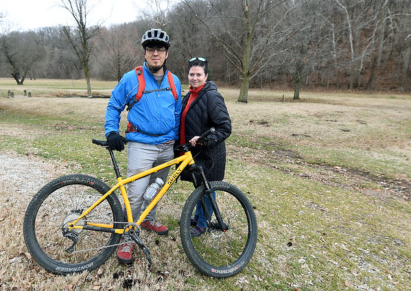 Mountain bike enthusiasts Jeff Chance and Susan Eberle stand Saturday near a wooded area of Morse Park that they hope will soon be developed into a bike park and trail.<br /> Globe | Laurie SIsk